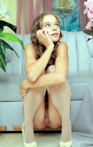 Fantastic tiny brunette Milena D stuffs a flower in her tight pussy